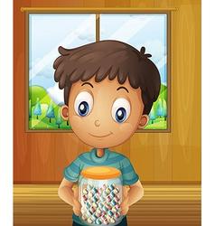 A boy holding a jar candy balls vector