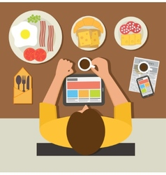 Breakfast time Office man reading news on tablet vector image
