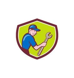 Handyman holding spanner crest cartoon vector