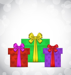 Set Christmas gift boxes on light background vector image vector image