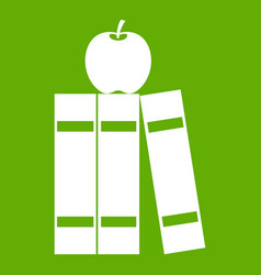 stack of books and apple icon green vector image