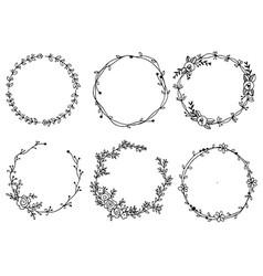 Hand drawn wreaths design elements vector