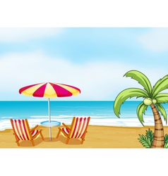 The beach with an umbrella and chairs vector image