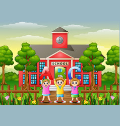 happy children showing alphabets in front of schoo vector image