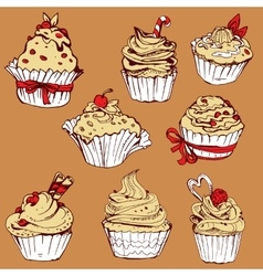 Set of hand drawn decorated sweet cupcakes - vector