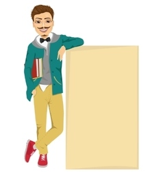 student boy leaning against a blank board vector image