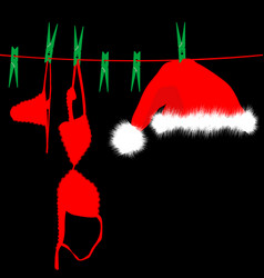 Hanging red underwear and santa claus hat on vector