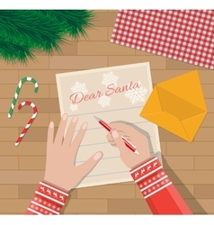 Child Hand with pen Writing letter to santa claus vector image vector image
