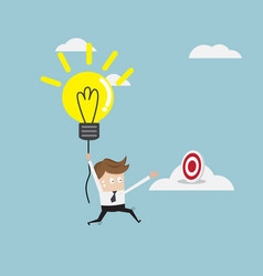 businessman flying with bulb idea to target on vector image