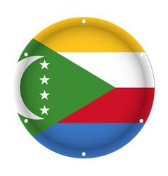 Round metallic flag of comoros with screw holes vector
