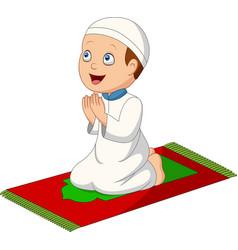 cartoon muslim boy praying on prayer rug vector image