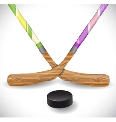 Hockey sticks and hockey puck vector image
