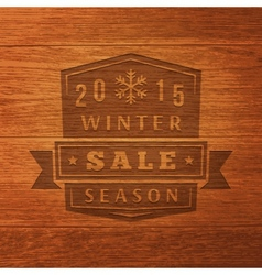 2015 winter sale label on wood texture background vector