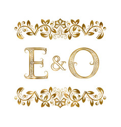 e and o vintage initials logo symbol vector image