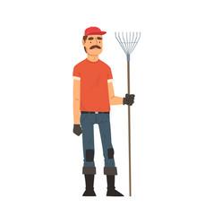 Man gardener standing with rake male farmer vector