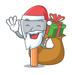 Santa with gift vintage putty knife on mascot vector