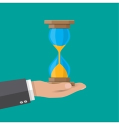 Human hand holds old style hourglass clocks vector image vector image
