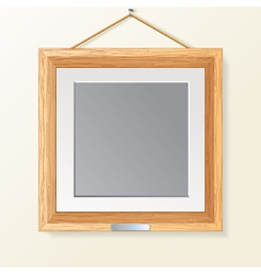 blank wooden photo frame on wall vector image