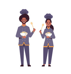 Cooks couple professional chefs holding plates vector