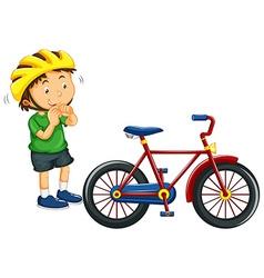 Boy wearing helmet before riding bike vector