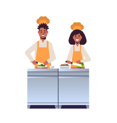 Cooks couple professional chefs chopping fresh vector