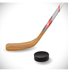Hockey stick and hockey puck vector image