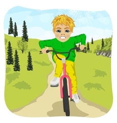 Serious boy riding his bike outdoor in countryside vector