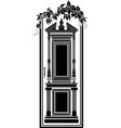 antique door entwined with ivy vector image