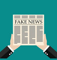 hands holding fake news newspaper flat style vector image vector image