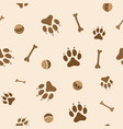 Seamless pattern with dog paws bones and balls