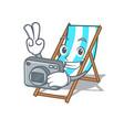 photographer beach chair mascot cartoon vector image