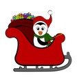 penguin on a christmas sledge vector image vector image