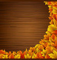 wooden background with autumn leaves vector image vector image