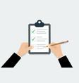 checklist - hand holding clipboard checklist vector image vector image