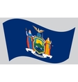 Flag of New York state waving on gray background vector image vector image