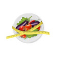 Vegetables on a plate with measuring tape Dieting vector image vector image
