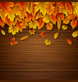wooden background with autumn leaves falling vector image