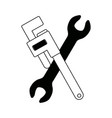 plumbers wrench and mechanics spanner crossed vector image