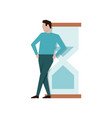 businessman leaned on a big hourglass break time vector image vector image