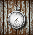 pocket watch lying on a wooden surface vector image vector image