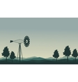 Silhouette of windmill and tree scenery vector image