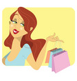 cute redhead woman with shopping bags vector image vector image