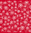 simple snowflakes on red vector image vector image