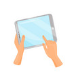 human hand holding tablet computer and touching vector image vector image
