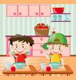 happy boys having breakfast in kitchen