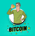 pop art handsome man holding golden bitcoin coin vector image