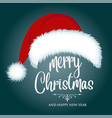 christmas card with santa hat and wishes vector image