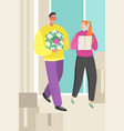 a young couple bringing boxes to to a new home vector image vector image