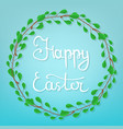 calligraphy lettering happy easter on blue vector image vector image