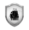 metallic shield with black silhouette of family